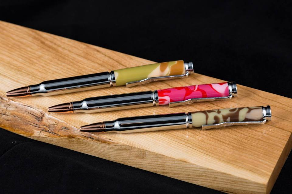 $45 chrome Bullet twist pens in pink, green, and desert camo