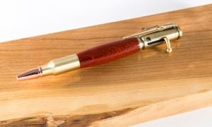 Padauk wood with gold hardware. Bolt action pen